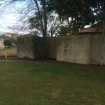Pelican Waters Rendered wall - before